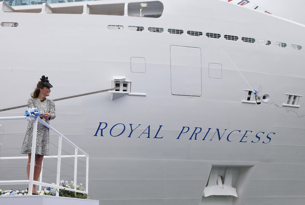 Catherine, Duchess of Cambridge cuts the rope to release the bottle of Champagne to officially name Princess Cruises's 'Royal Princess' in 2013. Source: Getty