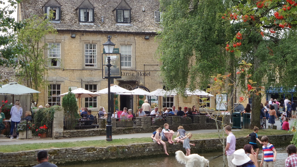 A magic summer day at Bourton-on-Water. Source: Village to Villa